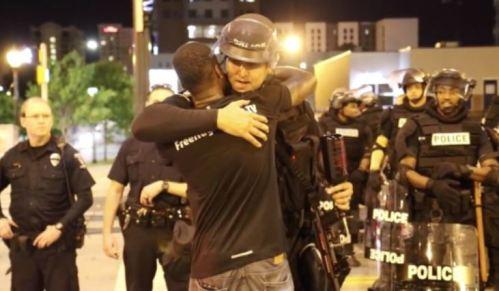 protestor-hugging-cop
